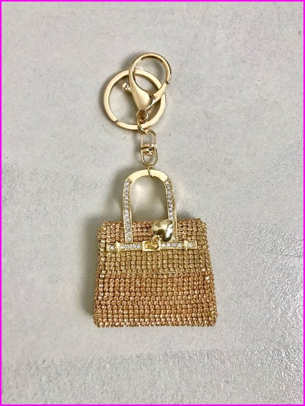 Charms mini bag in swarovski dorato.