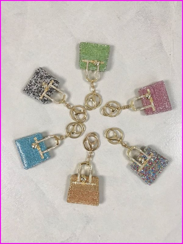 Charms mini bag in swarovski .